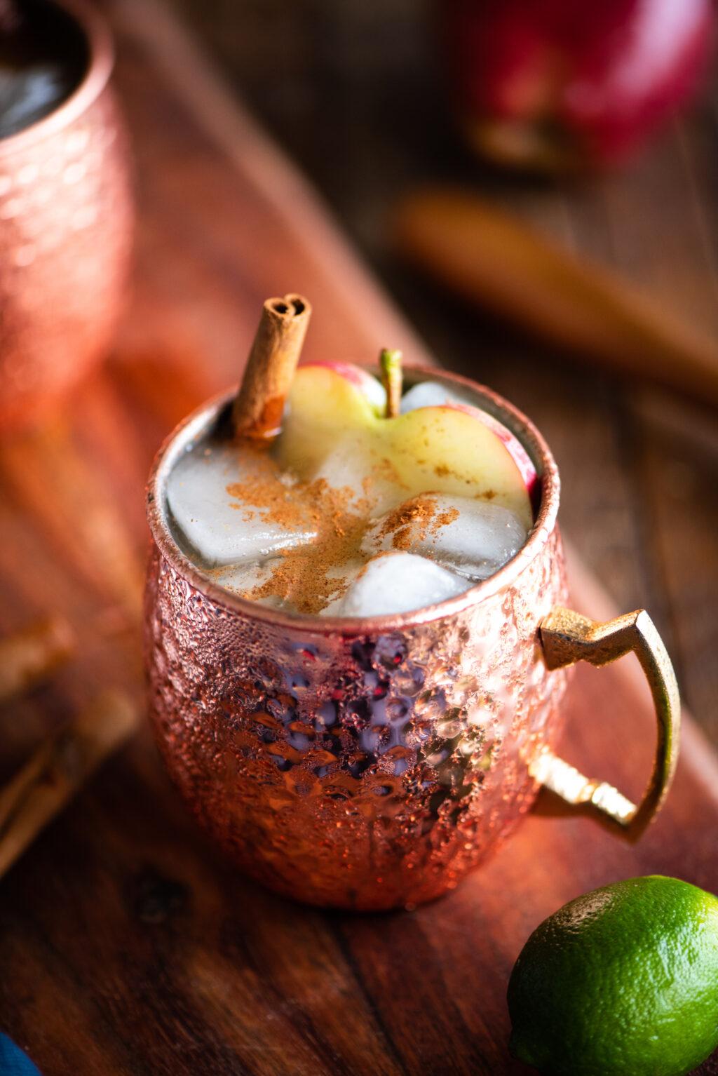 apple cinnamon moscow mule in a copper mug